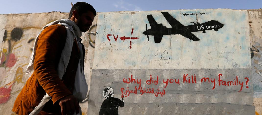 Muurschildering tegen drones in Jemen
